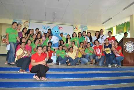 Teachers Danny, Dom, Ivy, Myrtle and Leah with the faculty and staff of Kamuning Elementary School.