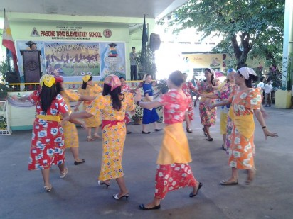 The female teachers of Pasong Tamo Elementary School perform during the Linggo ng Wika celebration last August.