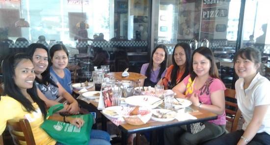 Teacher Brigitte shares a meal with her co-teachers from Pasong Tamo Elementary School.