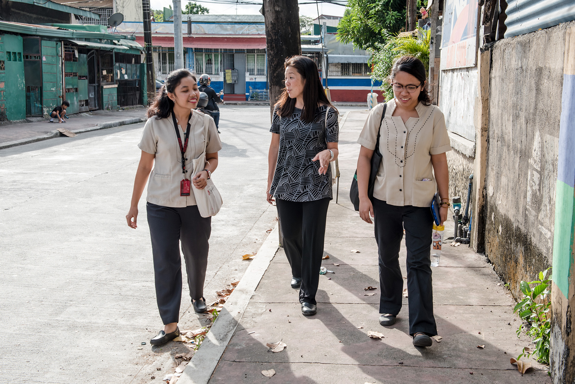 Teach For America – Hawai'i Executive Director Jill Murakami-Baldemor with 2018 Marikina City Teacher Fellows Jen Clemente and Edz Lebrino on their to a student's house near Concepcion Elementary School